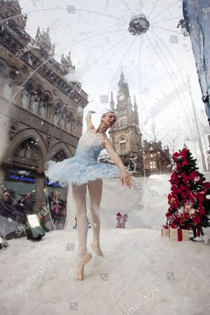 Stock Photo of Claire Robertson from Scottish Ballet inside a giant snow globe, dressed as the Good Snow Flake