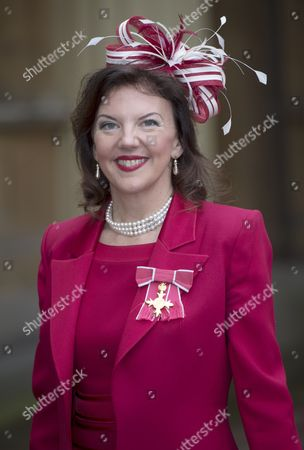 Violinist Tasmin Little with her OBE for Services to Music
