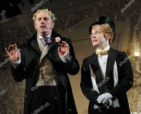 Don Gallagher as Achille Blond and Joshua McGuire as Cis Farringdon