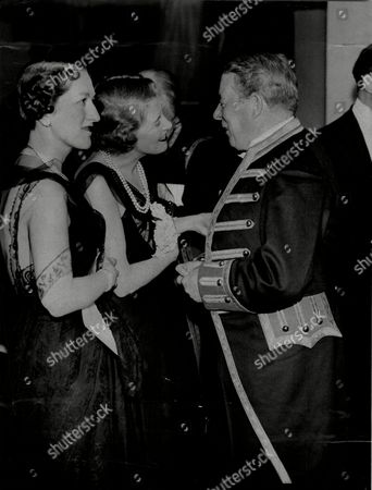 Editorial photo of Mrs Kathryn Miller And Lady Portarlington Seen Talking To Sir Seymour Hicks At The Mammoth Cabaret Supper And Ball At Grosvenor House Held In Aid Of The Actors' Benevolent Fund.