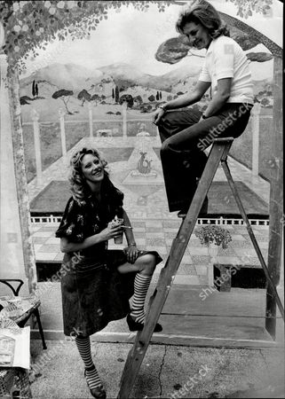 Sue Lloyd Actress Painting Mural On Her Garden Wall With Neighbour Jean Hedley Wife Of Actor Jack Hedley (not Shown) 1976.