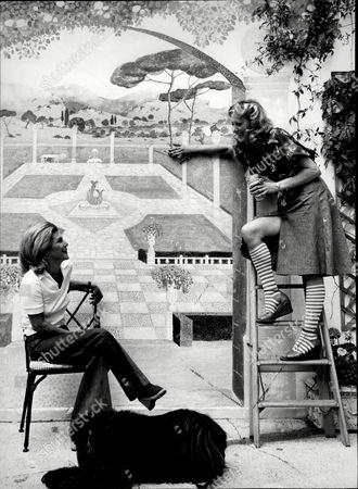 Sue Lloyd Actress Painting Mural On Her Garden Wall With Neighbour Jean Hedley Wife Of Actor Jack Hedley (not Shown) And Dog 1976.