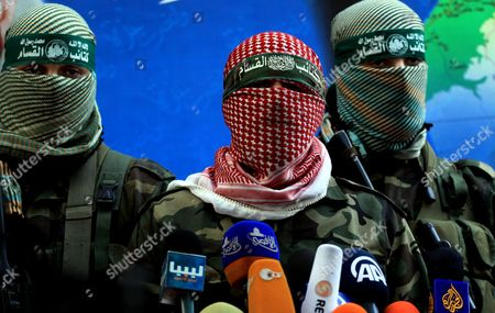 Stock Picture of Abu Obaida, the spokesman for the Ezzedine Al-Qassam Brigades, the armed wing of Hamas, speaks during a news conference in Gaza City at the house of their late leader Ahmed Jaabari, who was killed when an Israeli air strike hit his car on November 14