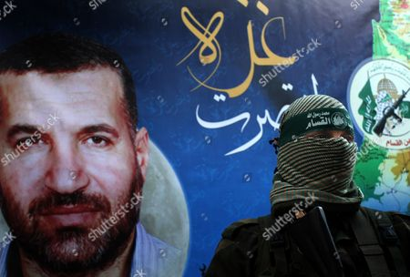 Ezzedine Al-Qassam Brigades, the armed wing of Hamas, during a news conference in Gaza City at the house of their late leader Ahmed Jaabari, who was killed when an Israeli air strike hit his car on November 14