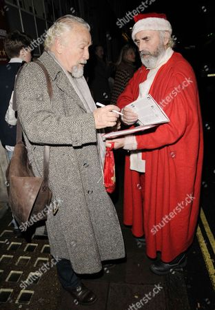 Paul Freeman with a fan dressed as Father Christmas
