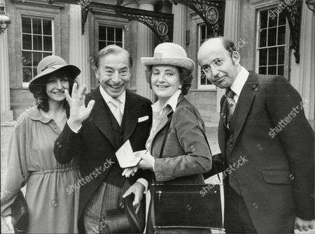 Musician And Band Leader Joe Loss (2nd Left) With His Family At Buckingham Palace For His Investiture (obe) Joshua Alexander 'joe' Loss Lvo Obe (22 June 1909 A 6 June 1990) Was A British Musician Popular During The British Dance Band Era And Was Founder Of The Joe Loss Orchestra.