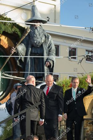 Martin Freeman, right, with Peter Hambleton and Mark Hadlow, and the 9.4 metre tall sculpture of Gandalf the wizard