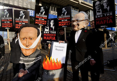 Protesters dressed as David Cameron and Rupert Murdoch