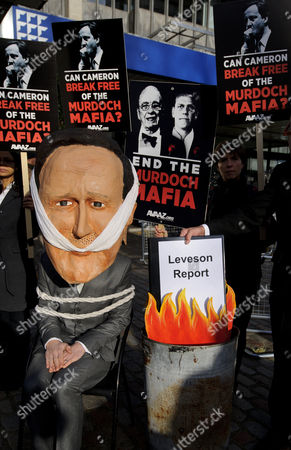 Protester dressed as David Cameron