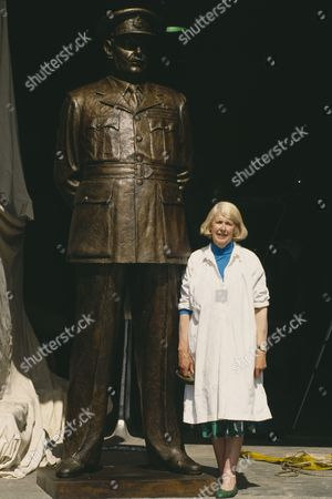 Faith Winter with statue of Bomber Harris