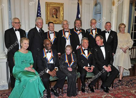 From left to right, back row: David M. Rubenstein Chairman of the John F. Kennedy Center for the Performing Arts, former U.S. President Bill Clinton, John Paul Jones, Jimmy Page, Robert Plant, David Letterman, Michael M. Kaiser, President of the John F. Kennedy Center for the Performing Arts, and Meryl Streep. From left to right, front row: U.S. Secretary of State Hillary Clinton, Buddy Guy, Natalia Makarova, Dustin Hoffman and Michael Stevens, producer of the annual Kennedy Center Honors