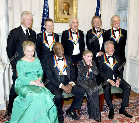 From left to right, back row: Former U.S. President Bill Clinton, John Paul Jones, Jimmy Page, Robert Plant, and David Letterman. From left to right, front row: U.S. Secretary of State Hillary Clinton, Buddy Guy, Natalia Makarova, and Dustin Hoffman.