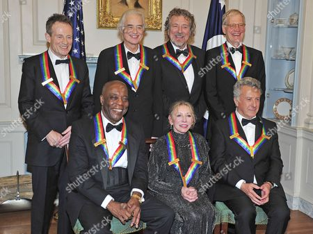 From left to right, back row: John Paul Jones, Jimmy Page, Robert Plant, and David Letterman. From left to right, front row: Buddy Guy, Natalia Makarova, and Dustin Hoffman.