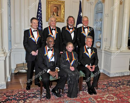 From left to right, back row: John Paul Jones, Jimmy Page, Robert Plant, and David Letterman. From left to right, front row: Buddy Guy, Natalia Makarova, and Dustin Hoffman