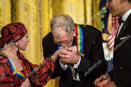 David Letterman kisses the hand of ballerina Natalia Makarova as President Barack Obama looks on