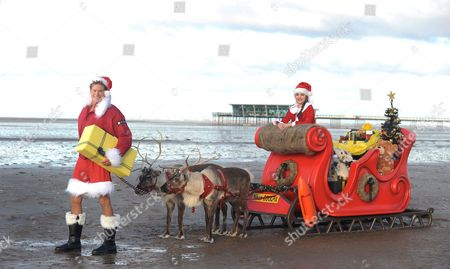 Stock Image of David Hasselhoff as Father Christmas with Angelina Ryan