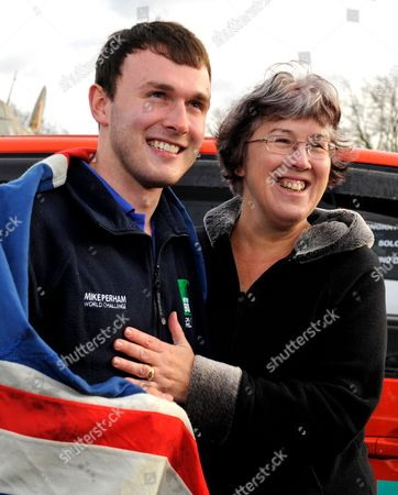 Stock Photo of Mike Perham with his mother Heather, after successfully circumnavigating the globe in a Spaceship Camper van