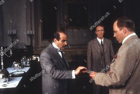 David Suchet as Hercule Poirot, Hugh Fraser as Captain Hastings and Geoffrey Bateman as Marcus Waverly