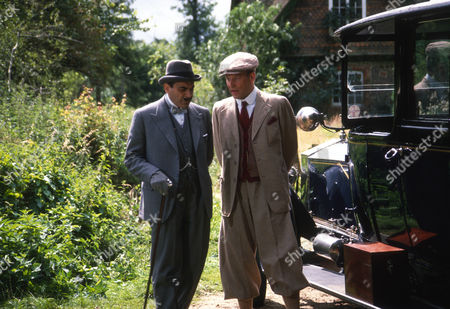 David Suchet as Hercule Poirot and Geoffrey Bateman as Marcus Waverly