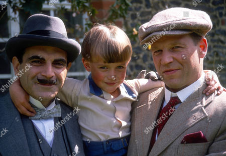 David Suchet as Hercule Poirot, Dominic Rougier as Johnnie Waverly and Geoffrey Bateman as Marcus Waverly