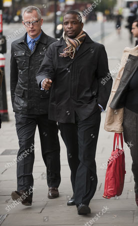 Duwayne Brooks Friend Of Murdered Teenager Stephen Lawrence Leaving The Old Bailey With Former Deputy Commissioner Brian Paddick After Giving Evidence In The Trial Of David Norris And Gary Dobson. 17.11.11.