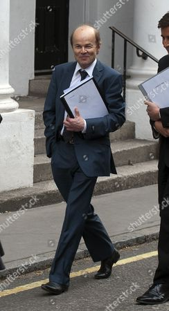 Former Joanna Yeates Murder Suspect Christopher Jefferies Leaving The High Court In London After Giving Evidence To The Leveson Phone-hacking Enquiry. 28.11.11.