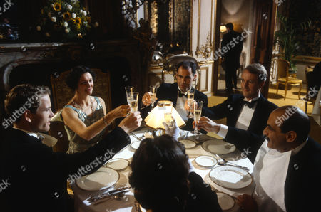 Stock Photo of Ben Pullen as Jack Renauld, Katherine Fahey as Bernadette Daubreuil, Terence Beesley as Stoner, Hugh Fraser as Captain Hastings and David Suchet as Hercule Poirot