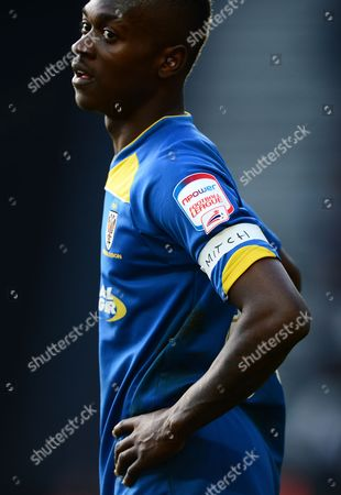 Toby Ajala of AFC Wimbledon wears an armband in memory of Mitchell Cole, former Oxford United, Southend and Stevenage player who passes away this week