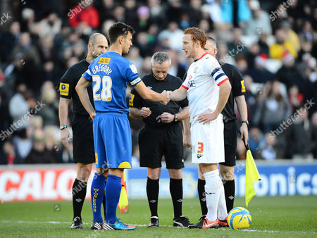 Stock Image of Steven Gregory of AFC Wimbledon and Dean Lewington of MK Dons shake hands prior to kick off