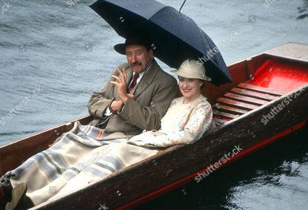 Philip Jackson as Chief Inspector Japp and Pauline Moran as Miss Lemon