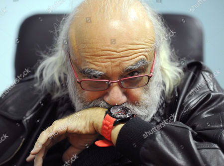 Demis Roussos speaks to the media after his arrival at the O.R. Tambo International Airport