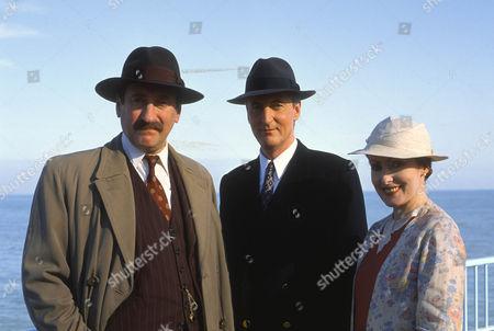 Philip Jackson as Chief Inspector Japp, Hugh Fraser as Captain Arthur Hastings and Pauline Moran as Miss Lemon