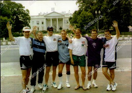 Liverpool And England Footballer Phil Neal With England Players At The White House In Usa L-r Martin Keown Tim Flowers Assistant Manager Phil Neal Andy Sinton David Batty David Platt And Tony Dorigo Philip George Neal (born 20 February 1951) Is A Retired English Footballer Who Played For Northampton Town Liverpool And Bolton Wanderers As A Full Back. He Is One Of The Most Successful English Players Of All Time Having Won Eight First Divisions Four League Cups Five Fa Charity Shields Four European Cups One Uefa Cup And One Uefa Super Cup During His Eleven Years At Liverpool. He Later Returned To Bolton Wanderers As Manager Leading Them To Victory In The Football League Trophy Before Spells Managing Coventry City Cardiff City And Manchester City. Neal Also Had A Long Career With The England National Team Winning 50 Caps And Playing In The 1982 World Cup. Phil Neal's Nickname Whilst At Liverpool Was Zico - A Reference To The Brazilian Play Maker And A Compliment To Neal Who Was Known For Scoring Important Goals Throughout The Clubs History.