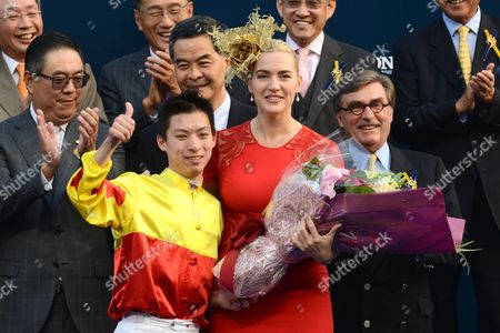 Kate Winslet presents a trophy to Matthew Chadwick, jockey of California Memory who won the Hong Kong Cup