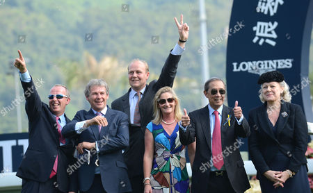 The connections of Red Cadeaux after they win The Longines Hong Kong Vase including (2nd L) Charlie Gordon-Watson, (3rd L) trainer Ed Dunlop and (2nd R) owner, R.J.Arculi