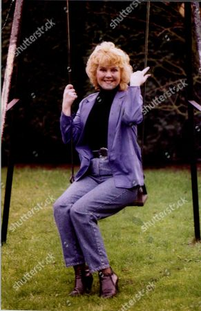 Stock Photo of Cheryl Murray Actress On Child's Swing 1995.