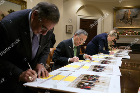 Stock Picture of Cabinet members sign copies of the official Cabinet photo, in the Roosevelt Room of the White House. Pictured, from left,  are: Defense Secretary Leon Panetta; Secretary of Energy Steven Chu; Secretary of State Hillary Rodham Clinton; Labor Secretary Hilda Solis; and Council of Economic Advisers Chair Alan Krueger.