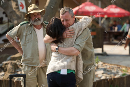 Du Plessis (Deon Stewardson) watches as Danny (Stephen Tompkinson) says goodbye to Alice (Dawn Steele) who is returning to the UK for a while.