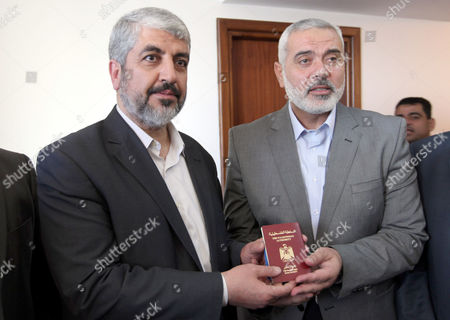 Palestinian Prime Minister in Gaza strip Ismail Haniyeh gives Hamas leader in exile Khaled Meshaal a diplomatic Palestinian passport