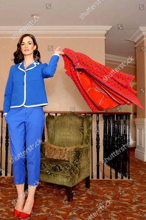 Model Karen Fitzpatrick wears Missoni polka dot jacket e880, blue knit blazer e485, blue crop pants e240