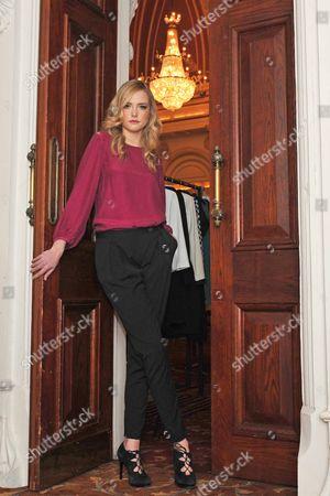 Model Danielle Winkworth wears Lennon Courtney  top e160 and black trousers e105