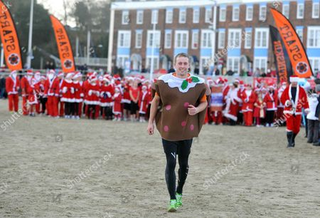 Editorial picture of The annual 'Bustin Skin Chase The Pudding along Weymouth Seafront' race, Weymouth, Dorset, Britain - 16 Dec 2012