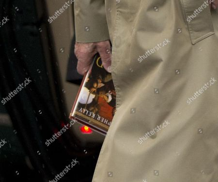 Stock Picture of Prince Philip with a copy of the book 'The End of Empire: Attila the Hun and the Fall of Rome' by Christopher Kelly