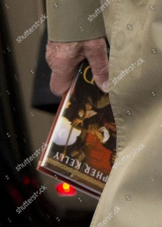 Prince Philip with a copy of the book 'The End of Empire: Attila the Hun and the Fall of Rome' by Christopher Kelly