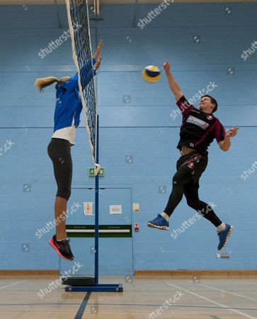 Editorial photo of 2012 Gb Volleyball Hopeful Denise Johns Blocks A Shot From Gloucester Rugby Player Freddie Burns At Hartpury College Gloucester.