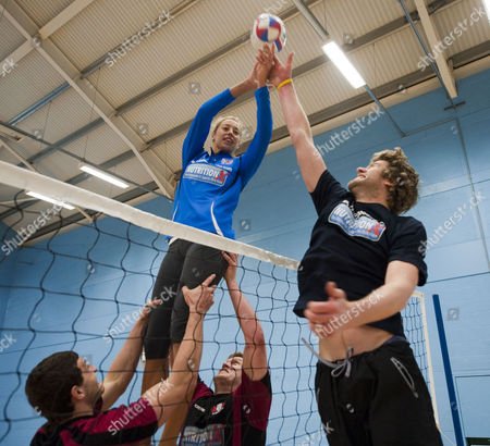 Editorial picture of Gloucester Rugby Players Jonny May And Luke Narroway Show Newly Married Volleyball Players Denise Johns And Jody Gooding How To Play Volleyball The Rugby Way At Hartpury College Gloucester.