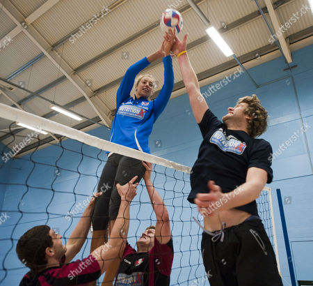 Stock Photo of Gloucester Rugby Players Jonny May And Luke Narroway Show Newly Married Volleyball Players Denise Johns And Jody Gooding How To Play Volleyball The Rugby Way At Hartpury College Gloucester.