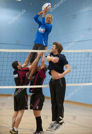 Stock Image of Gloucester Rugby Players Jonny May And Luke Narroway Show Newly Married Volleyball Players Denise Johns And Jody Gooding How To Play Volleyball The Rugby Way At Hartpury College Gloucester.