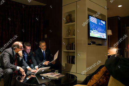 President Barack Obama works on his acceptance speech with Jon Favreau, Director of Speechwriting, and campaign advisor David Axelrod at a Chicago hotel, America