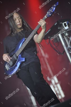 London United Kingdom - July 24: John Myung Of Dream Theater Performing Live Onstage At High Voltage Festival On July 24 2011 In London